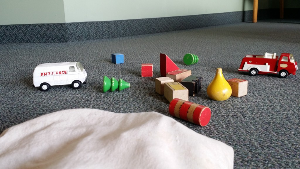 Stress of toys on ground with toy ambulance